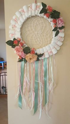I made this for my sister in law's baby shower. I new i wanted to make a diaper wreath/dreamcatcher but couldn't find any examples online. This is completely my own vision and im so pleased with the end result!
