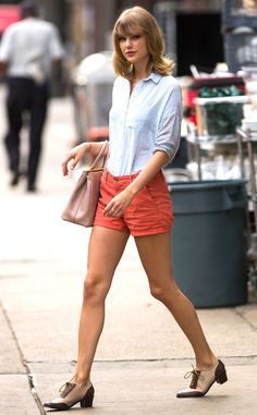 Short Cuts from Taylor Swift's Street Style  Taylor always manages to look perfectly polished even when spotted leaving the gym, like she was seen here wearing orange shorts and a pinstriped bouse.