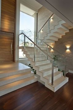 Glass balustrade staircase and planting including