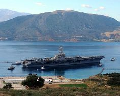 SOUDA BAY, Greece (Dec. 6, 2010) The aircraft carrier USS Harry S. Truman (CVN 75) departs Souda Harbor after a scheduled port visit.
