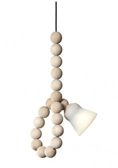 Dig this! The LED Earl Lamp has a hook that locates the light source to any position.The shade on the largest wooden pearl is also movable.