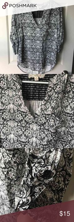 Patterned Top Black and white patterned split neck top. Had one front pocket and roll up sleeves with buttons. Features a slightly high low hem. Worn only once and is in great shape! Pink Republic Tops Blouses
