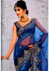 This blue net saree is nicely designed with resham, zari, sequins, stone, c-border and patch patti work in form of floral motif. Unique c-border work is making the saree look more beautiful. As shown blouse can be made available and also can be customized as per your style or pattern subject to fabric limitation. Slight variation in color and patch patti pattern is possible.