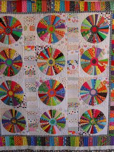 """Foundation pieced Quilt based on pattern in """"Quilts with a Spin"""" by Becky Goldsmith and Linda Jenkins. Most fabric in this quilt is printed with spots, which I slowly collected over a number of years. by Red Pepper Quilts Quilt Festival, Circle Quilts, Quilt Blocks, Quilting Projects, Quilting Designs, Polka Dot Quilts, Dresden Plate Quilts, String Quilts, Colorful Quilts"""