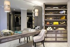 Dressing Room, London. Built and fitted by Chordal Green. Pale grey veneered joinery is enhanced by hand water-gilded drawer fronts, silvered mirrors, hand-forged handles and light fittings; creating a glamorous dressing room for a London apartment.