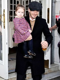 David Beckham carried his 19-month-old daughter, Harper, out of The Electic Cinema in London's Notting Hill Feb. 18.