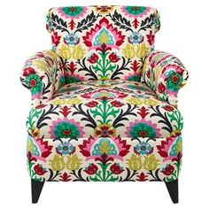 """Create a bohemian aesthetic in your home with this multicolor arm chair, showcasing tapered legs and a vibrant floral-inspired pattern.    Product: ChairConstruction Material: Wood and fabricColor: Desert flowerFeatures:  Nailhead trimMade in the USADimensions: 33"""" H x 33"""" W x 35"""" D"""