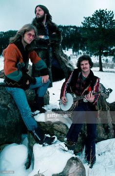 Gerry Beckley, Dewey Bunnel, and Dan Peek of folk-rock trio America stand in snow. America is best remembered for the anthemic 'A Horse with no Name'.