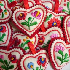 These hearts are embroidered by women from a folk art co-operative in Hungary.
