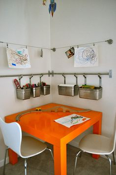 I really like this idea for hanging Char's stuff and getting it off the table. Maybe put art a little higher and add shelving or magnetic storage
