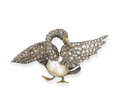 AN ANTIQUE PEARL AND DIAMOND SWAN BROOCH  C.1860