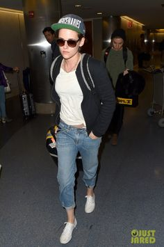 Kristen Stewart wearing Oliver Peoples O'Malley Sunglasses, Ambitious Mercenaries Letterman Snapback Hat, Chanel Patchwork Shearling Large Shopping Tote, Vans Authentic Canvas Sneakers, Big Star Joey Boyfriend Jeans and Vans Gainsbourg Fleece Jacket