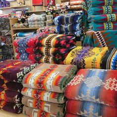 I'm just gonna get all those pendleton blankets and throw them on my bed. I love those patterns and bright colors!