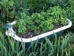 Creative tub planter for raised herb garden. Raised Herb Garden, Veg Garden, Garden Fencing, Edible Garden, Lawn And Garden, Garden Pots, Vegetable Gardening, Home Grown Vegetables, Planting Vegetables