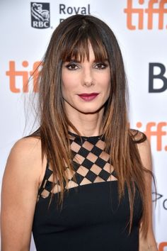 Sandra Bullock's piecey bangs perfectly complement her long, layered locks. #HairInspo