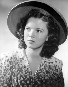 Shirley Temple  Ah! How I love her! She was such a cutie!