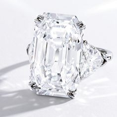 Sotheby's is back again with September's Important Jewels Auction, beginning in New York onSept. 24. The crown jewel of the auction is a 19.51 carat Harry Winston platinum and diamond ring, expected to bring in record breaking prices of $1.2-$1.8 million. The emerald step cut center stone is flanked by two trillion cut diamonds, a …