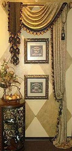 Asymetrical treatment defines a special area of the room, in gold, cream and browns.