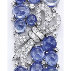 PLATINUM, SAPPHIRE AND DIAMOND 'RIBBON' BRACELET, PAUL FLATO Set with 45 cabochon sapphires weighing approximately 200.00 carats, gathered at the center by a bow, set with baguette and old European-cut diamonds weighing approximately 7.85 carats, length 7 inches, unsigned; circa 1935. With box signed Paul Flato.