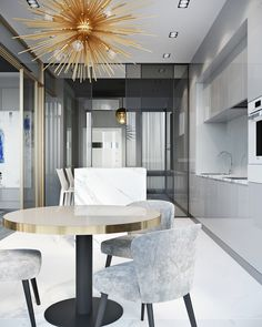Luxury mid-century lighting, high-gloss kitchen cabinetry, smoked grey glass wall partitions.