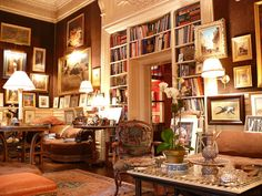 Warm tones, much-loved objects and books. I want to curl up in this room with my snuffly dogs at my feet.