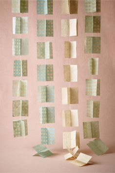product | blue hued 3D Paper Garland from BHLDN | perfect for a ceremony backdrop or reception decor