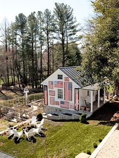 Framed cloth flags and recycled barn-wood flags prove collections can live outside.