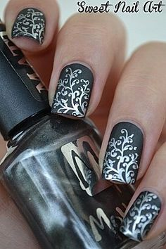 Mat dark grey with silver filigree