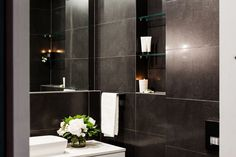 This luxurious powder room from The Block Triple Threat features the Exile Charcoal Lappato tile from Beaumont Tiles. For more bathroom inspiration check out http://www.beaumont-tiles.com.au/Room-Ideas/Bathrooms