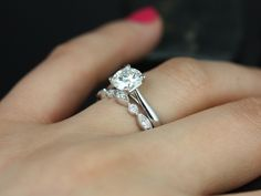 Solitaire ring either circle or cushion cut on cathedral setting with solid band and creative diamond wedding band!