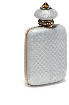 A Jewelled Two-Colour Gold-Mounted Guilloché Enamel Scent Bottle Marked Fabergé, with the workmaster's mark of Henrik Wigström, St Petersburg, apparently no date mark, scratched inventory number 25362 Rectangular, the flattened body enamelled in translucent oyster over a wavy guilloché ground, with bright-cut border at the sides, the hinged circular cover with rose-cut diamond collar and a cabochon ruby finial within rose-cut diamond border, with a gold-mounted cork stopper, marked inside…