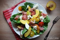 Light, summer salad with nectarines, prosciutto, mozzarella, cherry tomatoes and honey dressing served on Roman lettuce is an ideal idea for an open-air picnic snack.