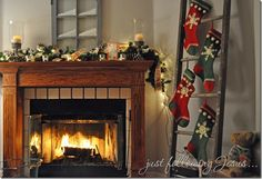love the stockings on the ladder idea... for those of us who don't have a fireplace!