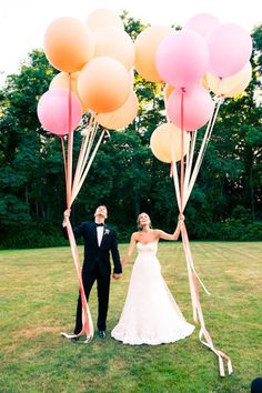 "One of our all time favorite ""No look first look"" ideas is a balloon release. But these giant balloons, in your wedding colors, make fantastic photo props regardless of when you take the photos! Take the lead of this couple, grab some brightly colored balloons, and have some fun!"