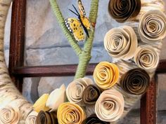 really cute spring wreath... love how this wrapped yarn looks like birch bark!!!  would be cool with felt flowers also....   from A Soft Place to Land blog.
