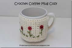 Definitely making this one !! crochet coffee mug cozy...link to pattern, love the flowers she put on!