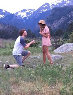 He proposed in the middle of an adorable meadow at the bottom of a mountain, and it's so perfect.