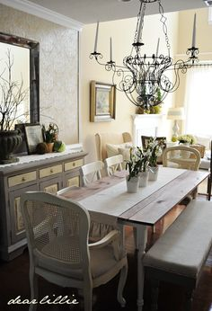 Love many things in this room ..the table..the table runner the decor on the side table