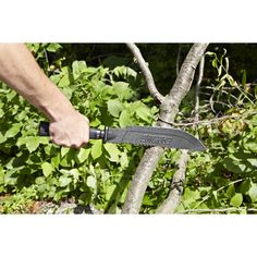 The perfect lawn and garden assistant  This heavy-duty Premium Machete is forged from one piece of solid steel and features a durable powder coated finish and comfortable shock reduction grip. Sharp offset serrated teeth on the backside of the hand sharpened edge will easily saw through small branches and vegetation. Perfect for use in the garden removing dead vegetation, with yard work, to cut and maintain trails, butcher wild game, and maintaining a campsite clearing. Includes a high…