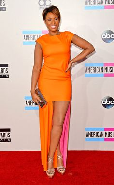 "AMA's 2013 - Jennifer Hudson wore a bright orange ""mullet dress"" by Christian Dior,"