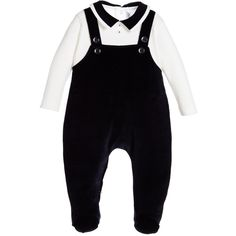 Boys smart, navy blue and ivory dungaree babygrow by Aletta, made in a soft cotton velour. This one piece babygrow is cleverly designed to look like dungarees and a shirt, with decorative buttons on the front and popper fastenings on the back and down the one leg.