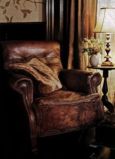 I've always wanted an old worn leather chair,.. and foot stool.