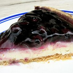 No Bake Fluffy Blueberry Cheesecake Recipe Desserts with cream cheese, sugar, cool whip, graham cracker crusts, blueberry pie filling