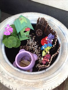 Upcycle a tyre by spray painting and turning it into a small world fairy garden! Easy, fun, frugal.