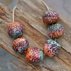 """Handmade Polymer Clay Dotted tri-color Beads, colored with Alcohol Inks. Each one individually created by hand and sealed to protect. 6 Ammonite Beads in this listing. Each piece is approximately .5"""" in diameter. They are hand molded and shaped so they are irregular by design."""