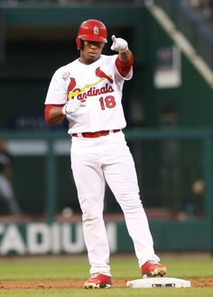 St. Louis Cardinals' Oscar Taveras gestures towards the dugout after driving in a run with a double in sixth inning action during a game bet...