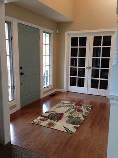 Halcyon green / blue front door, sw Nantucket dune walls, world market area rug