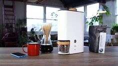 """IKAWA, a home coffee bean roaster that is currently being funded on Kickstarter. Users will first select an unroasted, """"green"""" artisanal coffee bean of their choice, before loading it into the IKAWA. The digital roaster is then controlled through an accompanying app for iOS or Android,"""