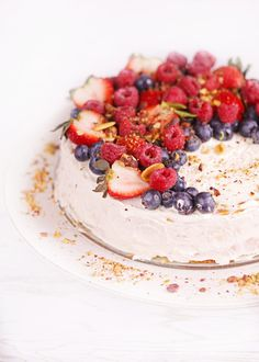 Gluten free cheesecake - light and airy gluten-free cheesecake decorated with berries with a delicious almond after-taste, dairy-free option available