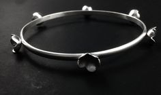 FIELDS OF FLOWERS, satin finished sterling silver bracelet by #POLAOSLO Design at www.polaoslodesign.com
